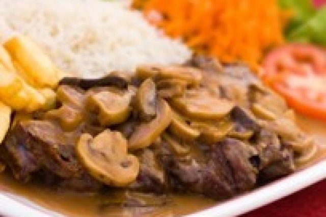 Steak in Wine Sauce with Artichokes and Almonds