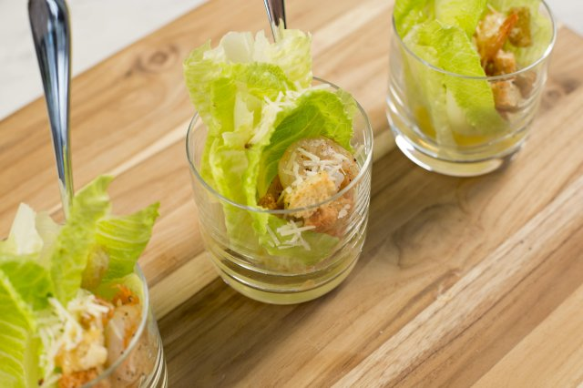 Caesar salad with shrimp in glass