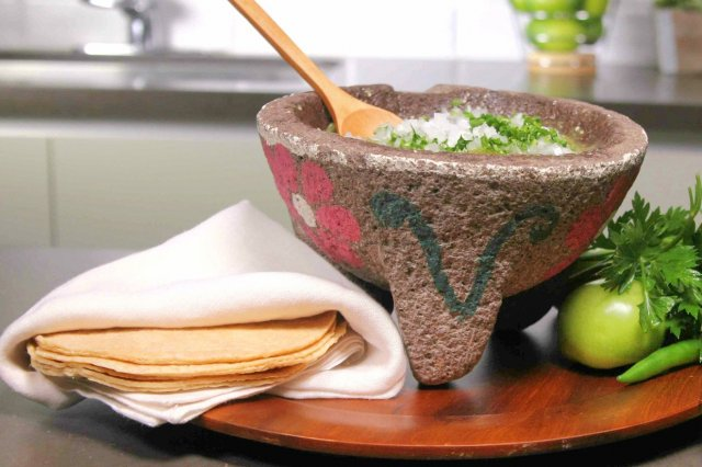 Green sauce in Molcajete with McCormick® Chicken Broth