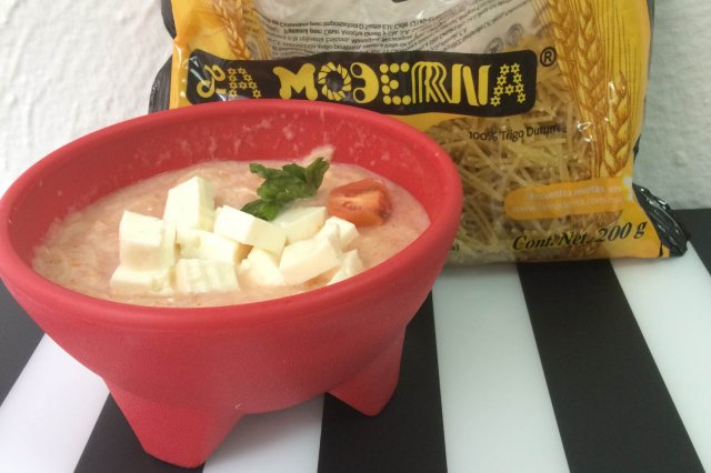 Soup with cream and panela cheese.