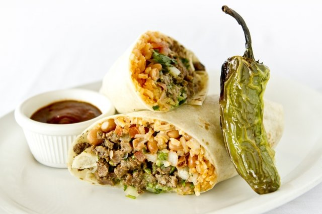 Picadillo Burrito in Green Sauce, Mexican Rice and Beans.