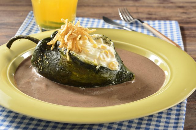 Poblano Chile Stuffed with Corn Grains and Panela Cheese with Bean Sauce