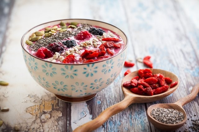Raw Carrot Muesli Bowl with Red Fruits and Goji