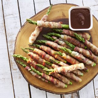 Asparagus Wrapped in Bacon with Prune Sauce