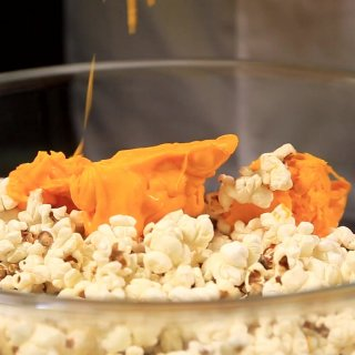 Add the chocolate to the popcornHow to make Halloween Pumpkins
